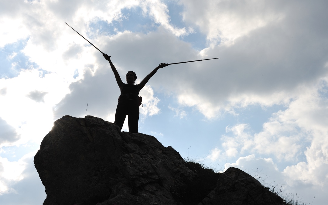 climber top of mountain silhouette